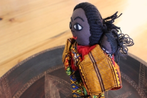 Each doll has a baby strapped into its back in the traditional African style